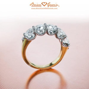Five stone ring in yellow gold setting